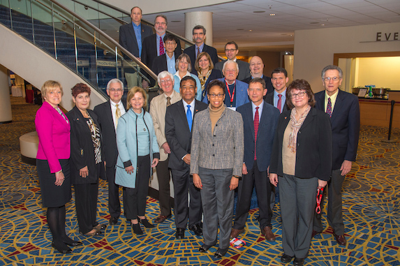 The Public Affairs and Information Committee, under the leadership of Maria Burka (front row, center left), is working to expand AIChE's interaction with government, prioritize issues that impact chemical engineers, and develop tools for members conducting outreach at the grassroots level.