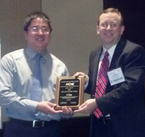 Yi Tang from UCLA receiving the 15c Plenary Lecture Award