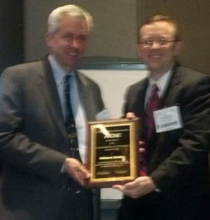 Bill Bentley, Univ. Maryland receiving the FPBE (Division 15) Award for 2012. John Morgan, session chair is on the right.