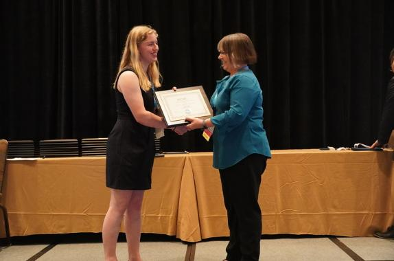 AIChE president Kimberly Ogden presented Jayme Currie with the John J. McKetta Undergraduate Scholarship award at the AIChE 2019 Annual Student Conference.