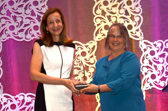 Sharon Beshouri (left) receives AIChE's 2019 AGILE Award from AIChE President Kimberly Ogden.