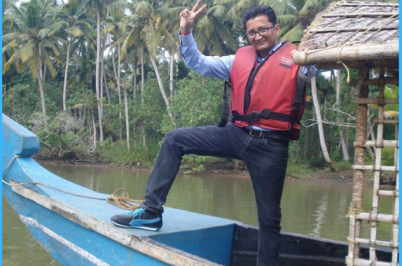 Ranjit on a traditional boat in Kerala.