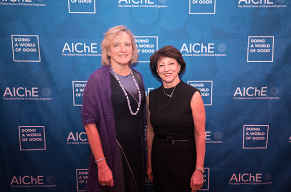 From left: June Wispelwey, AIChE's Executive Director and Chief Executive Officer, congratulates Doing a World of Good Medal recipient Nance Dicciani, Founder, President, and Chief Executive Officer of RTM Vital Signs LLC. Photo credit: Hassan Mokaddam, HMPhotoshoots