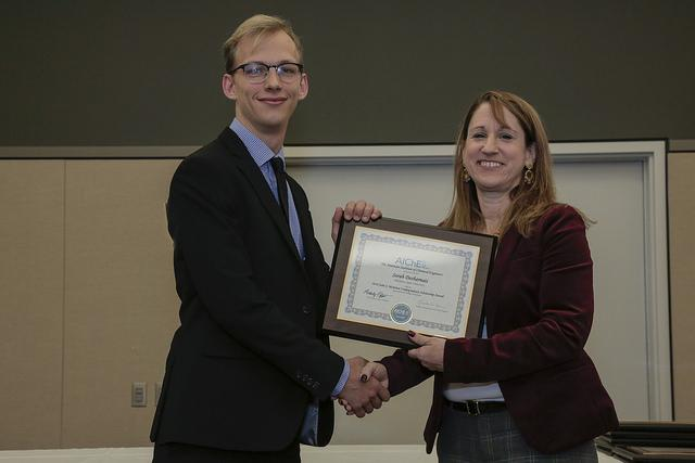 Joshua Sallee accepted the award at the AIchE 2018 Annual Student Conference on behalf of  Sarah Desharnais.