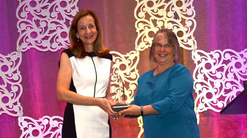 Sharon Beshouri (left) receives AIChE's 2019 AGILE Award from AIChE President Kimberly Ogden.