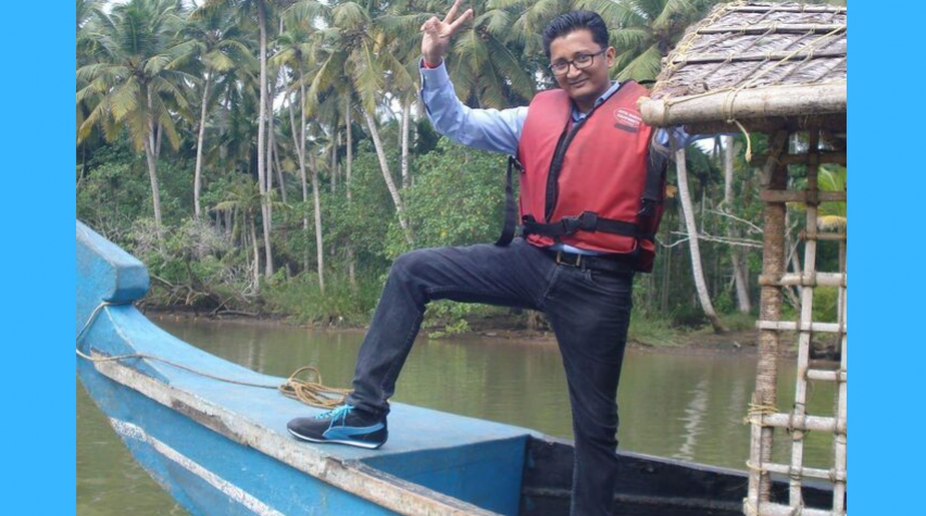 Ranjit on a traditional boat in Kerala.